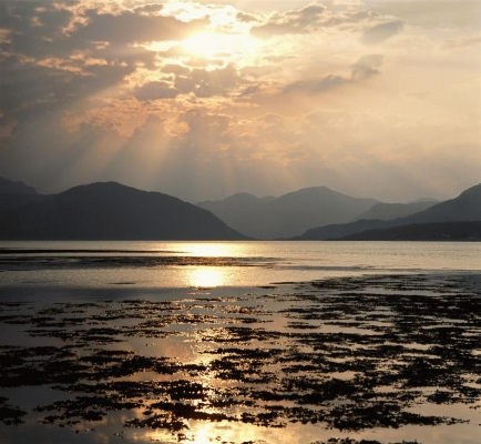 The sun's rays illuminate Loch Linnhe , Lochaber district