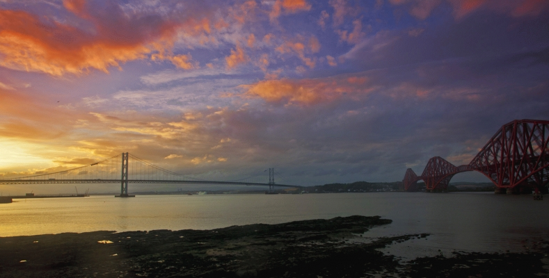 The rail and road bridges over the river Forth at sunset