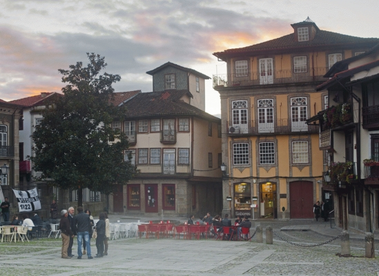 Autumn sunset in the square in Guimares Old Town, Portugal